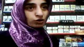 muslim lady protects her shop.3GP
