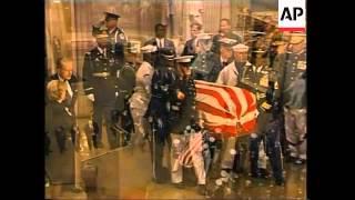 Reagan's casket in procession through DC to rotunda