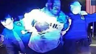 رجل شرطة من ديترويت يقوم بلكم فلويد دينت الأفروأمريكي عند إشارة المرور