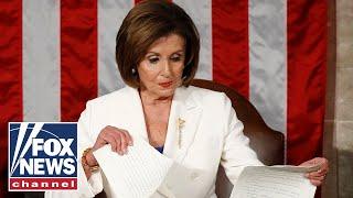 Nancy Pelosi tears up Trump's speech script behind him