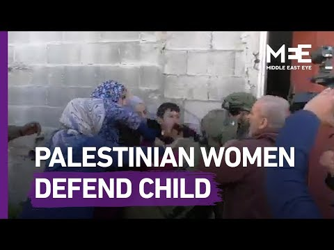 Palestinian Women Stand Against Israeli Soldiers