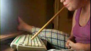 Arthrogryposis Handicapped Girl Typing With Drumstick!