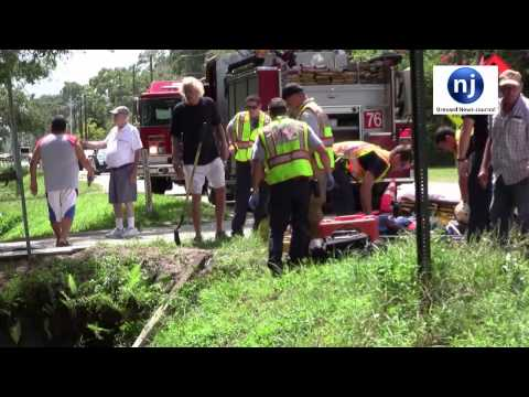 Melbourne Firefighters & Brevard County Firefighters Rescue Driver from Ditch