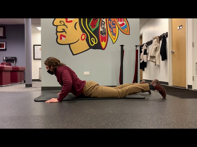 Prone Lumbar Extension with Arm Support