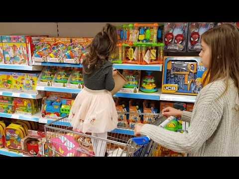 Having Fun  in the Shopping buying toys