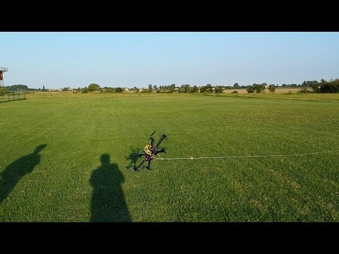 """Fly a drone bound to a retention cable  - Tested in """"Stabilize"""" mode (APM Copter V3.2)"""