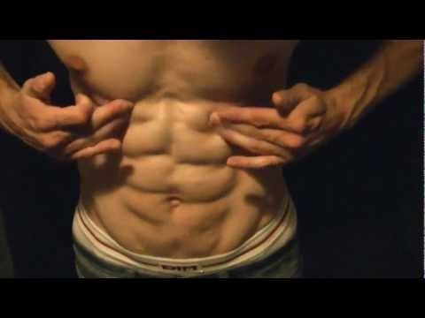 Hot abs flexing with oil.