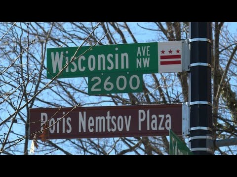 In message to Putin, Washington names plaza after slain critic