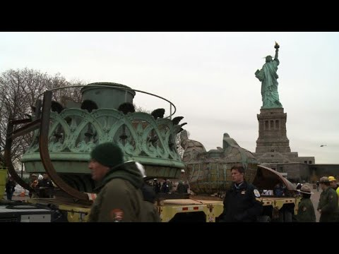 AFP news agency: Statue of Liberty's original torch is taken to new museum