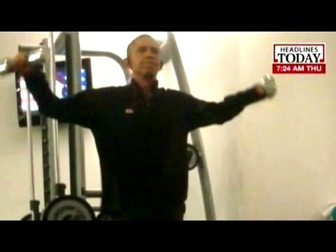 Leaked pictures from Polish hotel show Obama pumping weights in gym