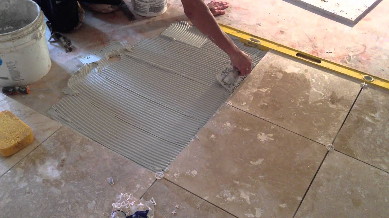 Tile Flooring Installation snapping a chalk line on this floor installation project How To Install Travertine Floor Tile Presented By Asap Plumbing And Tile Installers 904 346 1266 Youtube