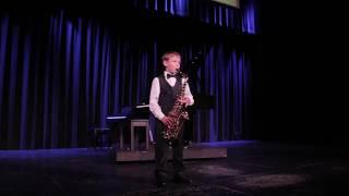 "Иван Байбородин, 7 лет, саксофон. 1. Моррис Альберт, ""Чувства""; 2. Д. Б. Кабалевский, ""Клоуны""."