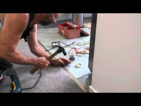 How to fix loose carpet edge along ceramic tiles on concrete floor