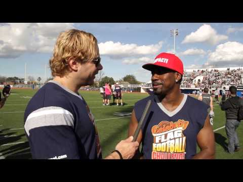 Eric the Trainer interviews Eddie Drummond during the Celebrity Sweat Flag Football Game 2013