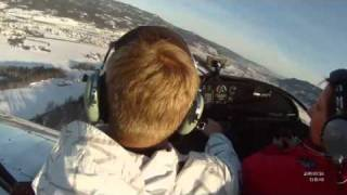Zenair CH650 take-off and landing on snow-covered grass field