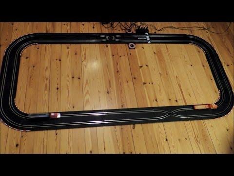 Slot cars race with Tyco trucks / lorries on Carrera tracks, lifelike proportions