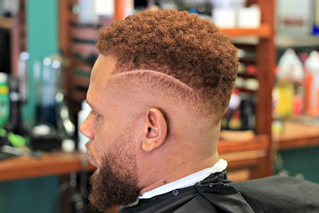 mid skin fade  with faded beard and twist top