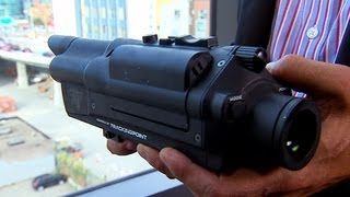 CNET News - High-tech rifle lets shooters hit a target 1000 yards away