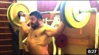 Dmitry Berestov - 130 x3 Behind the Neck Snatch Grip Press (In Speedos?!)