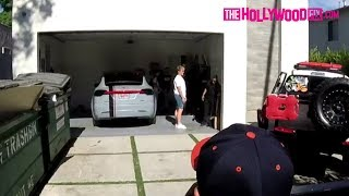 Jake Paul's Garage Door Gets Stuck While Parking His Newly Wrapped Tesla In The Team 10 House