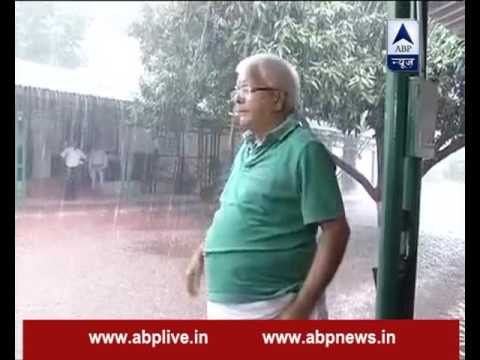 Lalu Prasad Yadav enjoys monsoon outside his Patna home