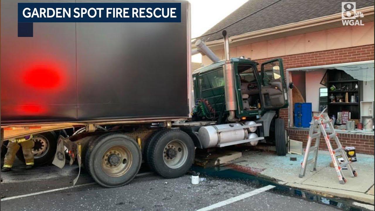 Crash scene: Trucks slam into New Holland store