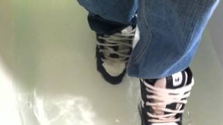 Wet DVS shoes, Polo Sport nylon jacket, jeans in tub