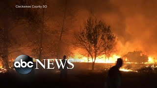 Death toll growing in explosive wildfires in the West