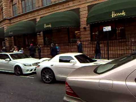Mercedes Benz SLS AMG White Parking and Gullwing Doors Opening in London