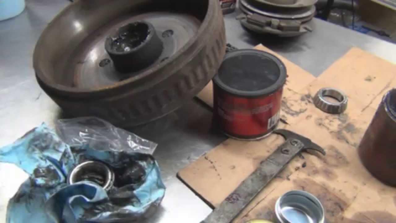 How to repack wheel bearings and install new wheel seal (Trailer Hub)  YouTube