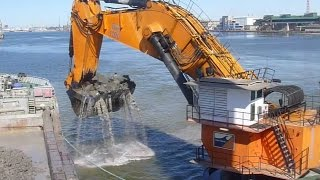 Monster Machine Backacter Goliath dredging in port of Klaipeda