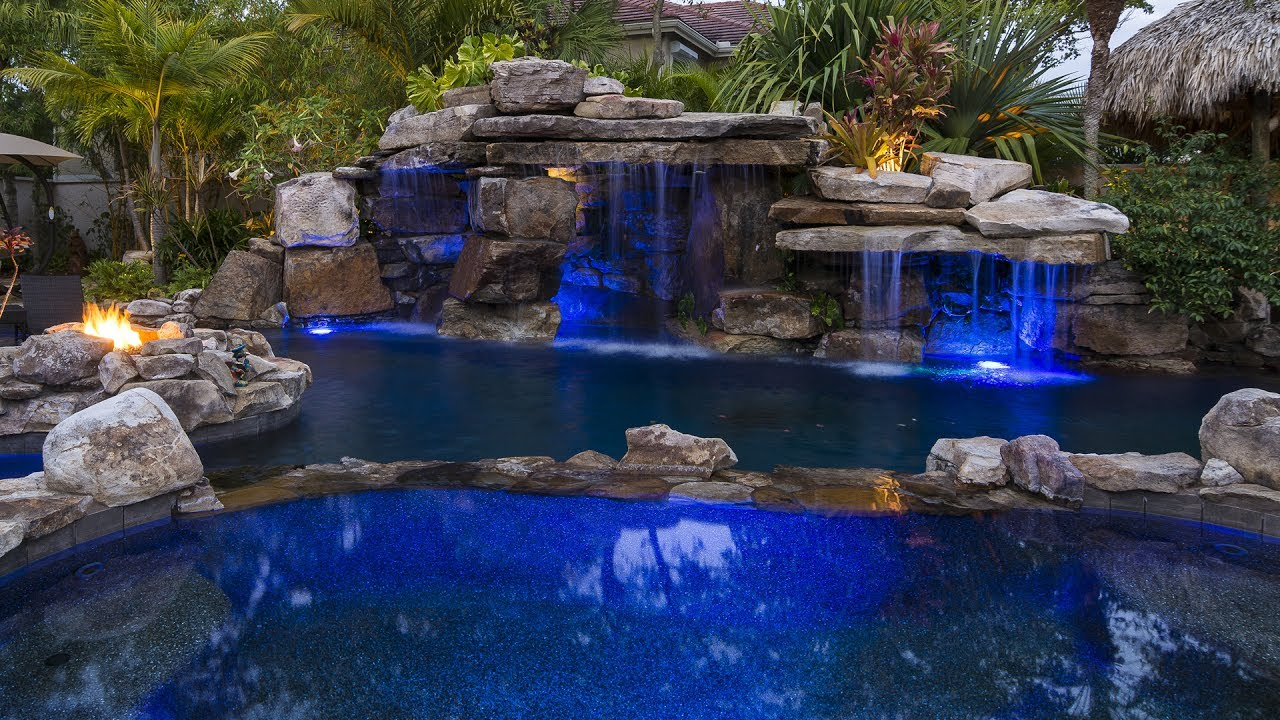 lucas lagoons siesta key rock waterfall pool with grotto spa and stream - Swimming Pools With Grottos