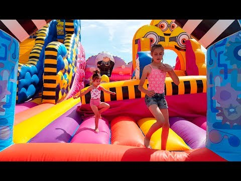 Thumbnail: Jumping on Giant Minions Bouncy Castle- Fun Activities for Kids!