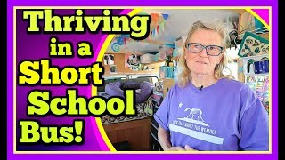 happy-retired-woman-thriving-in-a-short-school-bus-with-no-regrets