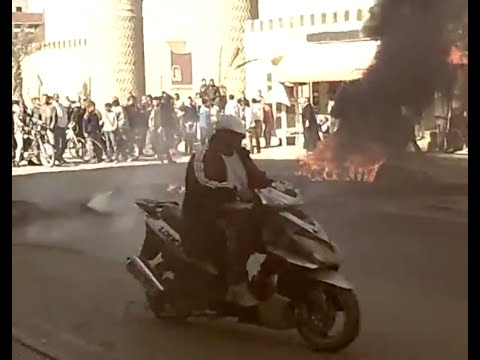 HD Tunisian street protests & burning tyres in Tozeur in Tunisia