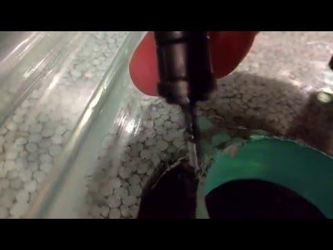 repairing chipped aquarium glass with Bondic.