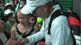 Elena Vesnina signing autographs at Wimbledon 2012