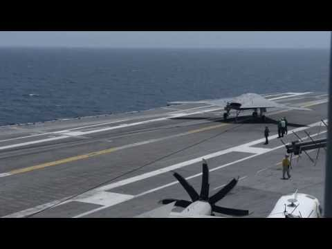 Stealth Bomber Landing on U.S. Navy Aircraft Carrier