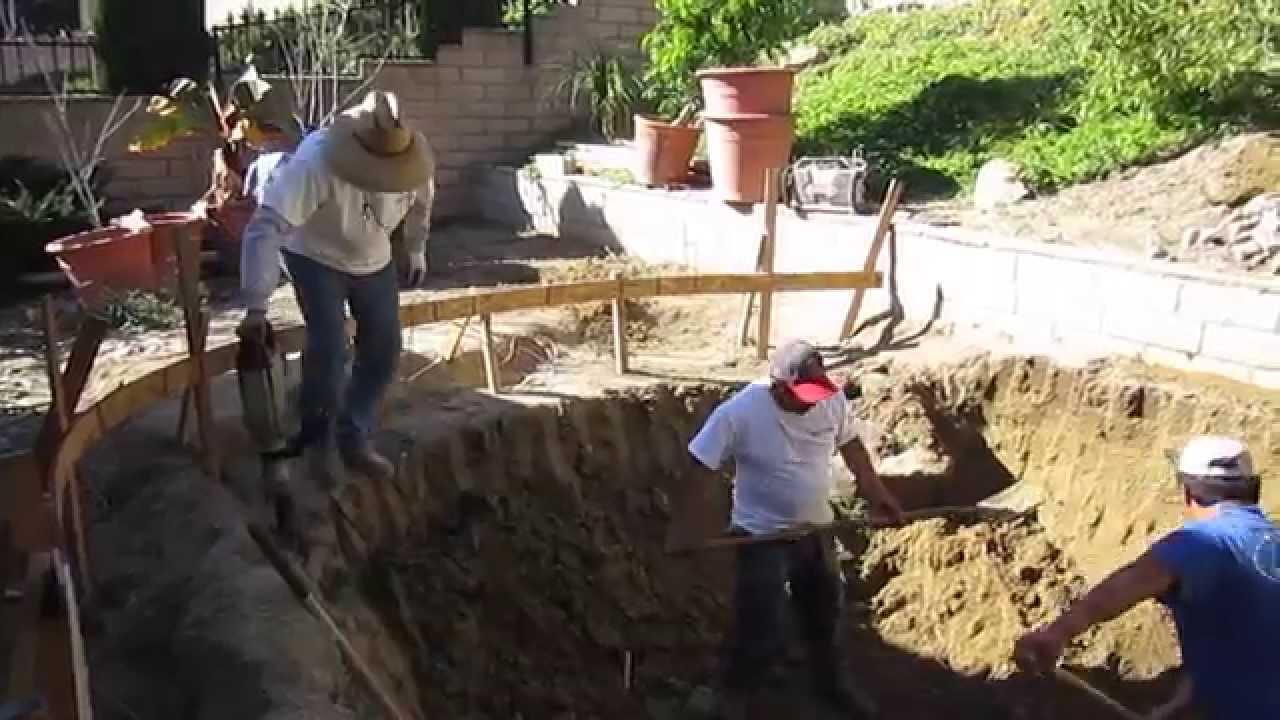Koi pond construction part 1 excavation youtube for Koi pool construction