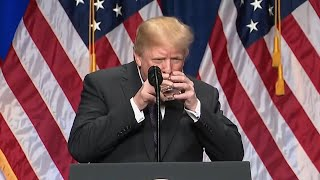Trump drinks water with two hands like a child during big speech on national security