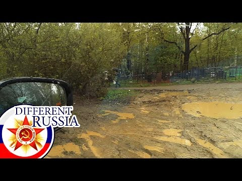 Russian Rasputitsa 2017: Mud Trash at Russian Cemetery Near Moscow. Dirty & Wet but with Flowers