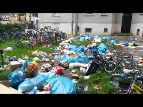 LiveLeak - Migrants Dump Garbage from their Balconies_Augsburg Asylum Center, Germany