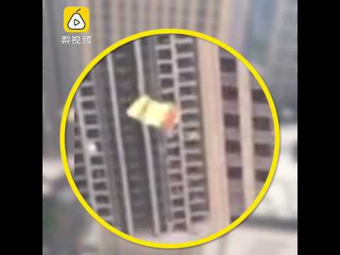 Daredevil skydives from a 41-storey high rise in the city of Guangdong