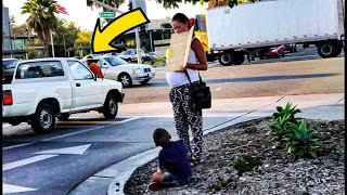 When She Sees Car Stop For Pregnant Panhandler, She Doesn't Hesitate