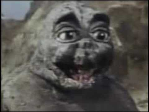 Show me pictures of baby godzilla