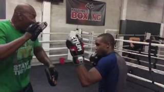 Padman McGriff doing pads with UFC fighter Marcus brimage