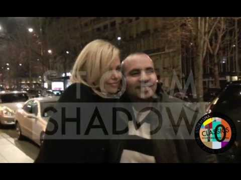 Charlize Theron offered flowers by a fan in paris