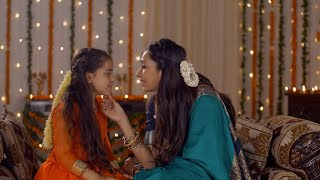 Indian mother spending quality time with her daughter during Diwali holidays