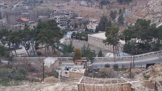 أخبار عربية - بدء خروج المعارضة المسلحة من وادي بردى نحو إدلب