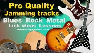 Am backing track rock blues style with lick suggestions
